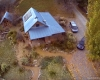 straw bale solar-powered home as seen from a camera drone.